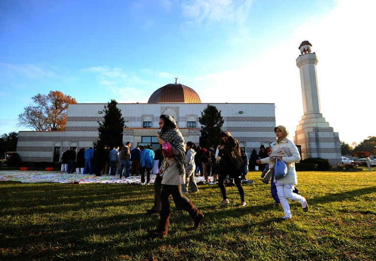 <p>Muslim devotees run to join a special morning prayer to mark the start of Eid-al-Adha festival at mosque in Silver Spring, Maryland.</p>