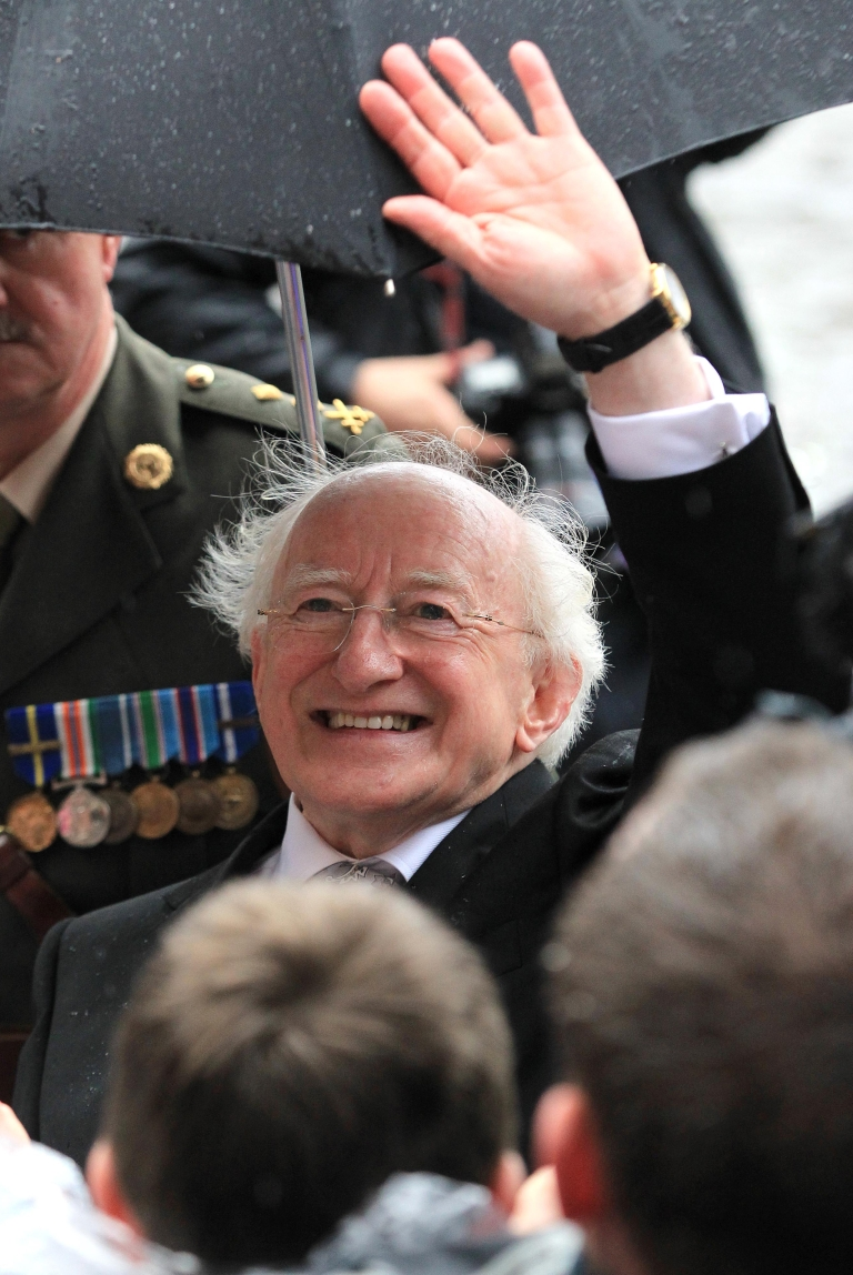 <p>Irish President Michael Higgins waves to well-wishers after his inauguration at Dublin Castle in Dublin on November 11, 2011</p>