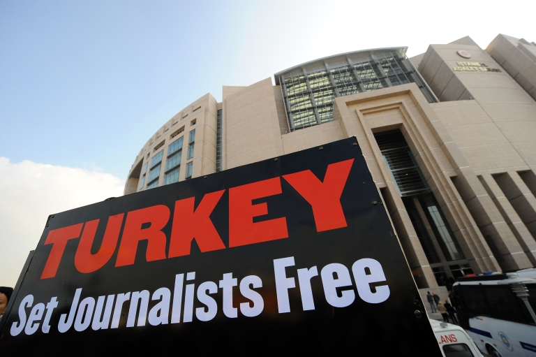 <p>A placard is pictured during a protest gathering journalists and human right activists in front of the courthouse in Istanbul during the trial of two prominent Turkish journalists Ahmet Sik and Nedim Sener on Nov. 22, 2011.</p>