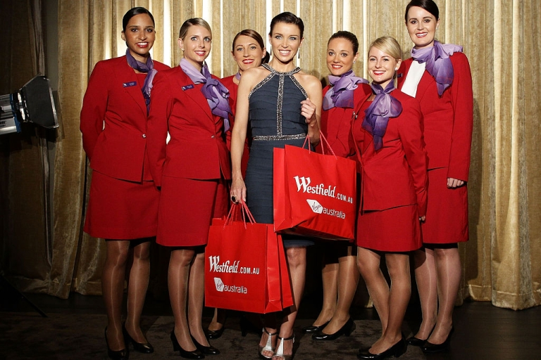 <p>Dannii Minogue poses with Virgin flight crew during the launch of a partnership between Virgin Australia's frequent flyer program and Westfield on line at Westfield Sydney on November 29, 2011 in Sydney, Australia.</p>