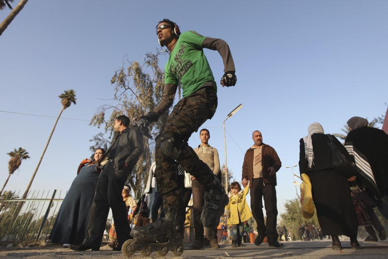 <p>A teenager rollerblades at Zawraa Park on Dec. 2, 2011, in Baghdad, Iraq. According to reports, Iraqi teens are being stoned to death for dressing 'emo.'</p>