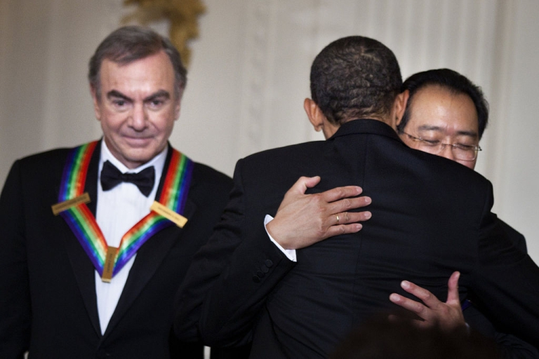 <p>WASHINGTON, DC - DECEMBER 4: (AFP OUT) Singer Neil Diamond (L) waits as U.S. President Barack Obama (C) hugs musician Yo-Yo Ma during a Kennedy Center Honors reception in the East Room on December 4, 2011in Washington, DC. For their accomplishments and contributions to the arts actress Meryl Streep, singer Neil Diamond, actress Barbara Cook, musician Yo-Yo Ma, and musician Sonny Rollins where etched recognized as this year's recipients of the Kennedy Center Honors.</p>