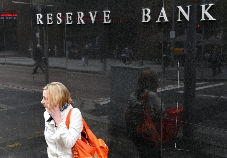 <p>A woman passes the Reserve Bank of Australia in Sydney on December 6, 2011 as official rates were slashed by 25 basis points for the second month in a row. Australians were handed an early Christmas present December 6 when the central bank cut interest rates for the second month in a row, but it warned the slowing global economy continued to pose risks.</p>