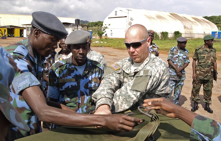 <p>US soldiers assist Ugandan military personnel in the fight against the LRA. Encouragement of an American military presence in Uganda is a sticking point with critics of the Kony 2012 campaign.</p>