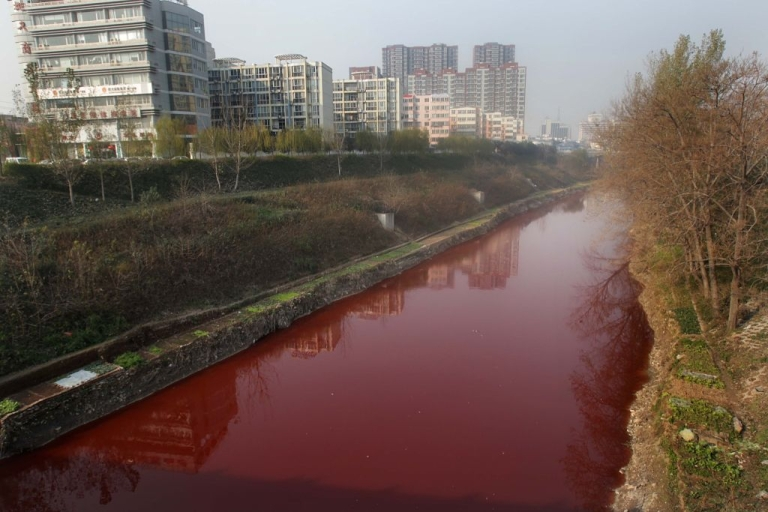 <p>This picture taken on December 13, 2011 shows the red polluted Jian River in Luoyang, north China's Henan province. The cause of the river becoming apocalyptic in character was red dye being dumped into the city's storm water pipe network, by two illegal dye workshops,the Luoyang Municipal Environmental Protection Bureau said on December 14, 2011, as authorities said they were working to shut down the workshops, and to disassemble the workshops' machinery.</p>