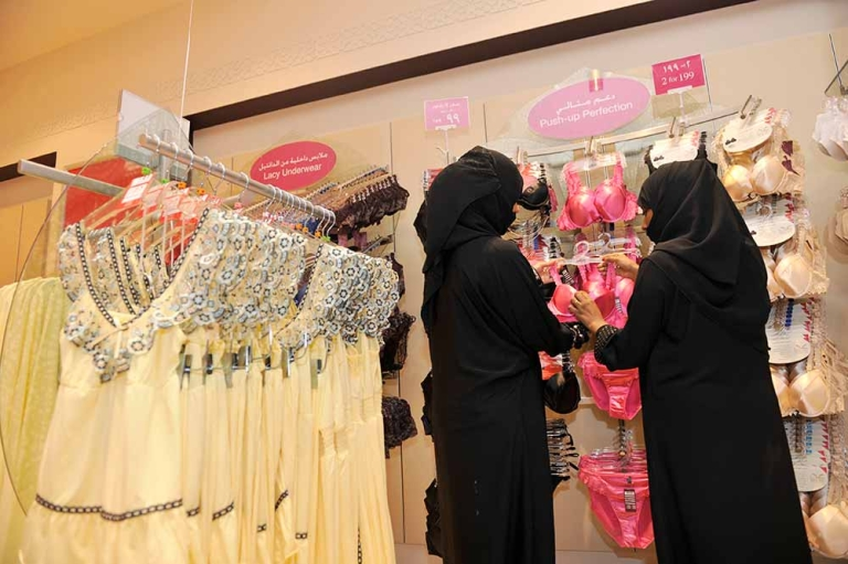 <p>Fully-veiled Saudi women shop at a lingerie store in the Saudi Red Sea port of Jeddah on January 2, 2012.</p>