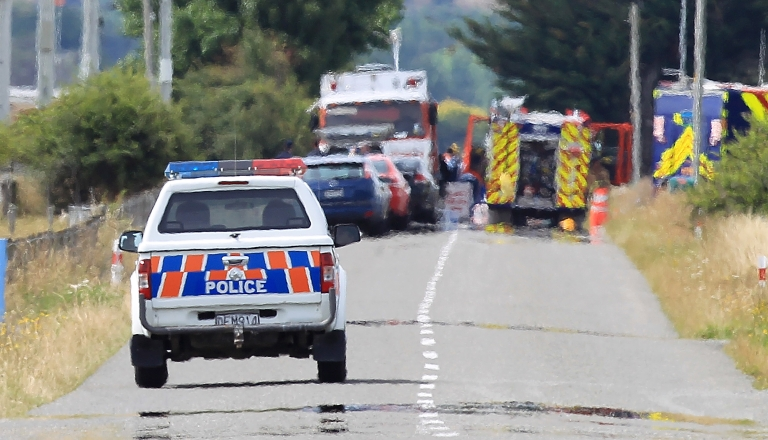 <p>A Police vehicle drives through the cordon heading to the accident site on January 7, 2012 in Carterton, New Zealand. Emergency services attended a hot air balloon crash that has killed 11 people in the early hours of Saturday near the Wairarapa plains town of Carterton. The balloon burst into flames and crashed killing all aboard.</p>