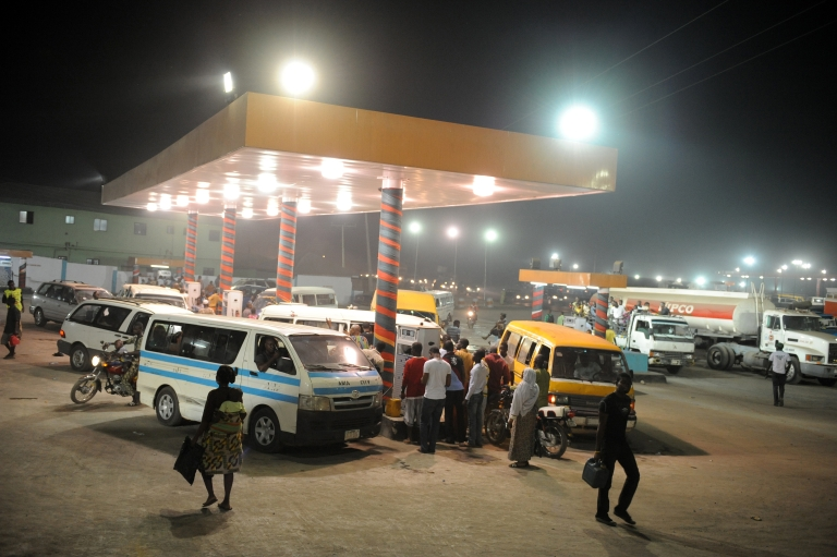 <p>Motorists line up at a gas station on the eve of a strike launched by the labour and civil society to force the government to revert to old fuel pump price, on January 8, 2012 in Lagos.</p>