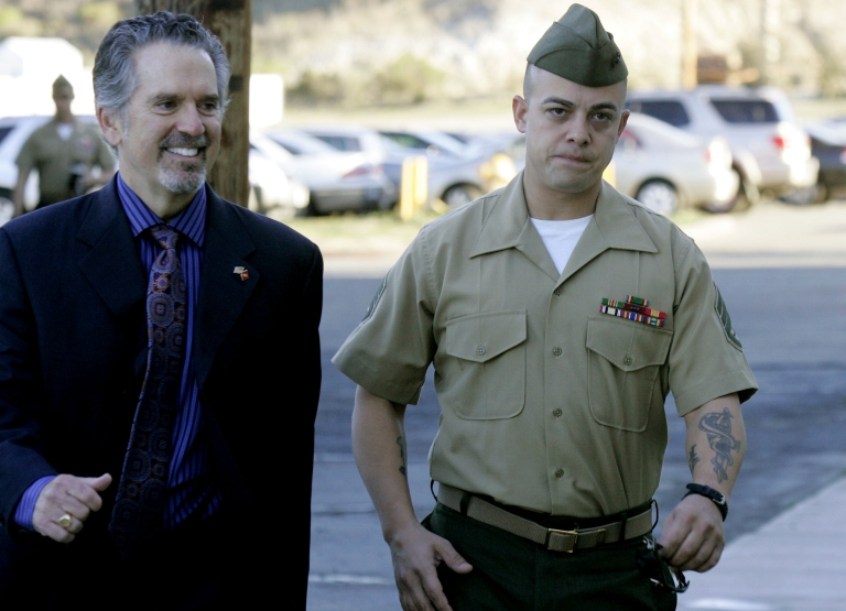<p>Staff Sgt. Frank Wuterich (R) walks into court with his defense attorney Neal Puckette during opening statements in the Haditha murders trial at Camp Pendleton on January, 9, 2012 in Oceanside, California.</p>