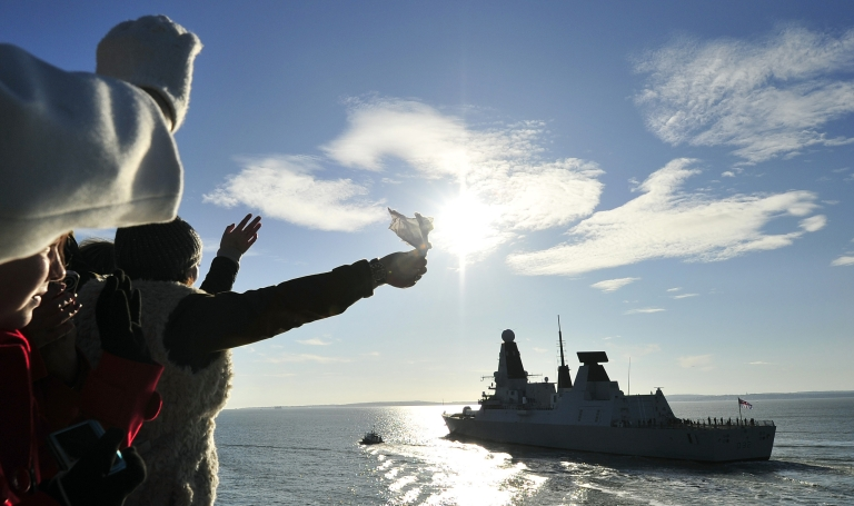 <p>People watch and wave as the new British Royal Navy destroyer HMS Daring, the first of the Royal Navy's new Type 45 destroyers, leaves the southern English harbour of Portsmouth on January 11, 2012 on its maiden voyage for a seven-month deployment to east of the Suez. Britain's newest warship is heading to the Gulf for its first mission at a time of tensions over Iran's threat to close the strategic Strait of Hormuz, a key transport route for oil. AFP PHOTO / GLYN KIRK (Photo credit should read GLYN KIRK/AFP/Getty Images)</p>