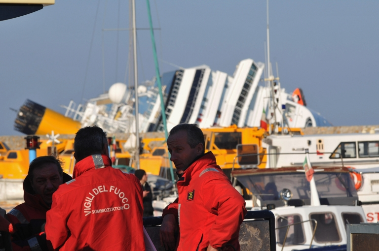 <p>Rescue teams attend the site of the stricken cruise ship Costa Concordia offshore from the island of Giglio.</p>