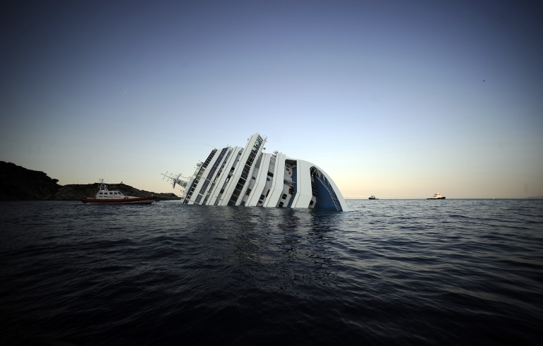 <p>The Costa Concordia, photographed January 14, 2012, after it ran aground and keeled over off the island of Giglio.</p>