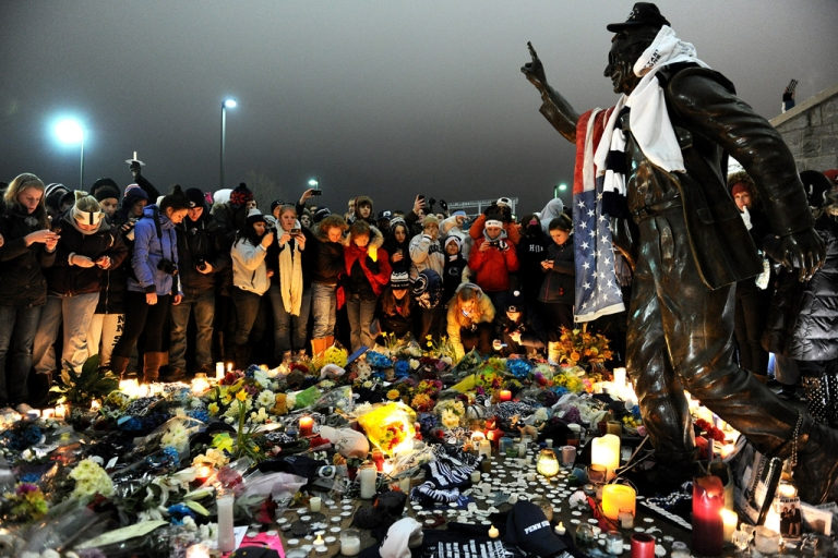 <p>Students and community members gather around the statue of Joe Paterno, the former Penn State football coach who died earlier in January, outside Beaver Stadium at Penn State on January 22, 2012 in State College, Pennsylvania. Paterno, who was 85, died due to complications from lung cancer.</p>
