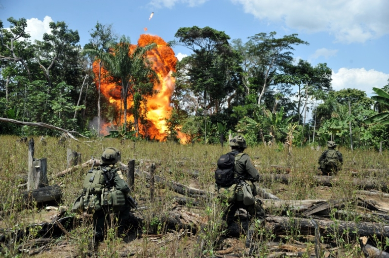 <p>Anti-narcotics forces blow up a laboratory for processing cocaine belonging to the Revolutionary Armed Forces of Colombia (FARC) in the municipality of Puerto Concordia, Meta department, Colombia, on Jan. 25, 2011.</p>