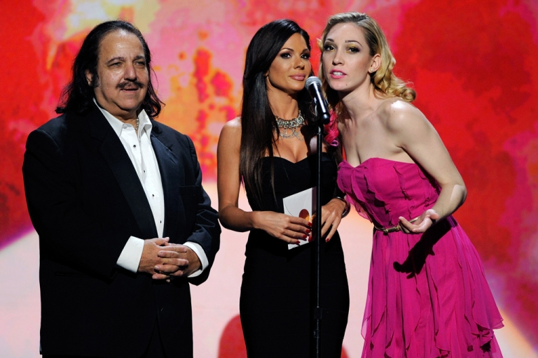 <p>Adult film actors Ron Jeremy, left, Kirsten Price and Lily LaBeau present during the 29th annual Adult Video News Awards on Jan. 21, 2012, in Las Vegas.</p>