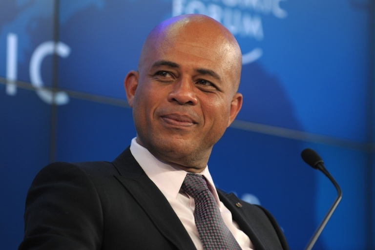 <p>Haitian President Michel Joseph Martelly listens during a session 'Building a better Haiti'' at the WEF meeting 2012 in Davos on January 27, 2012.</p>