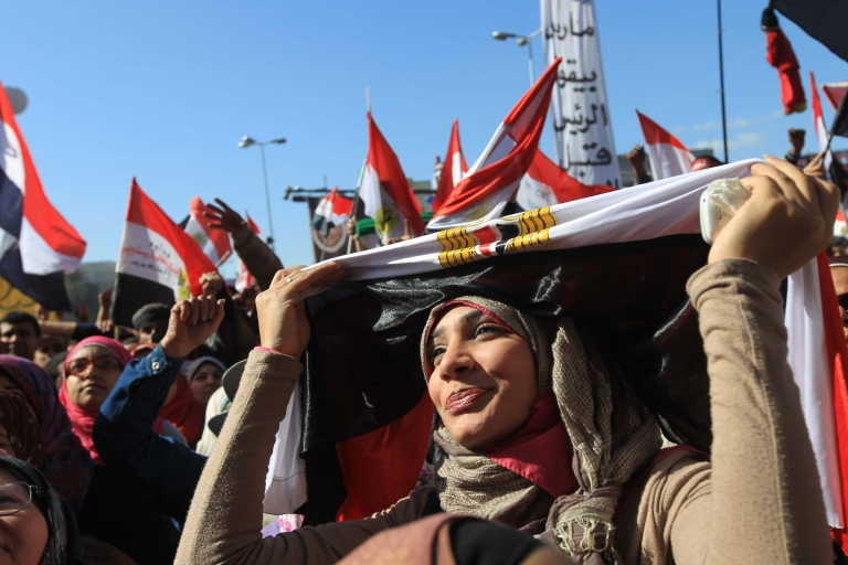 <p>An Egyptian women covers her head in a national flag as she demonstrates in Cairo's Tahrir Square on January 27, 2012, ahead of a mass rally to demand democratic change, a year after the country's revolt that overthrew the regime.</p>