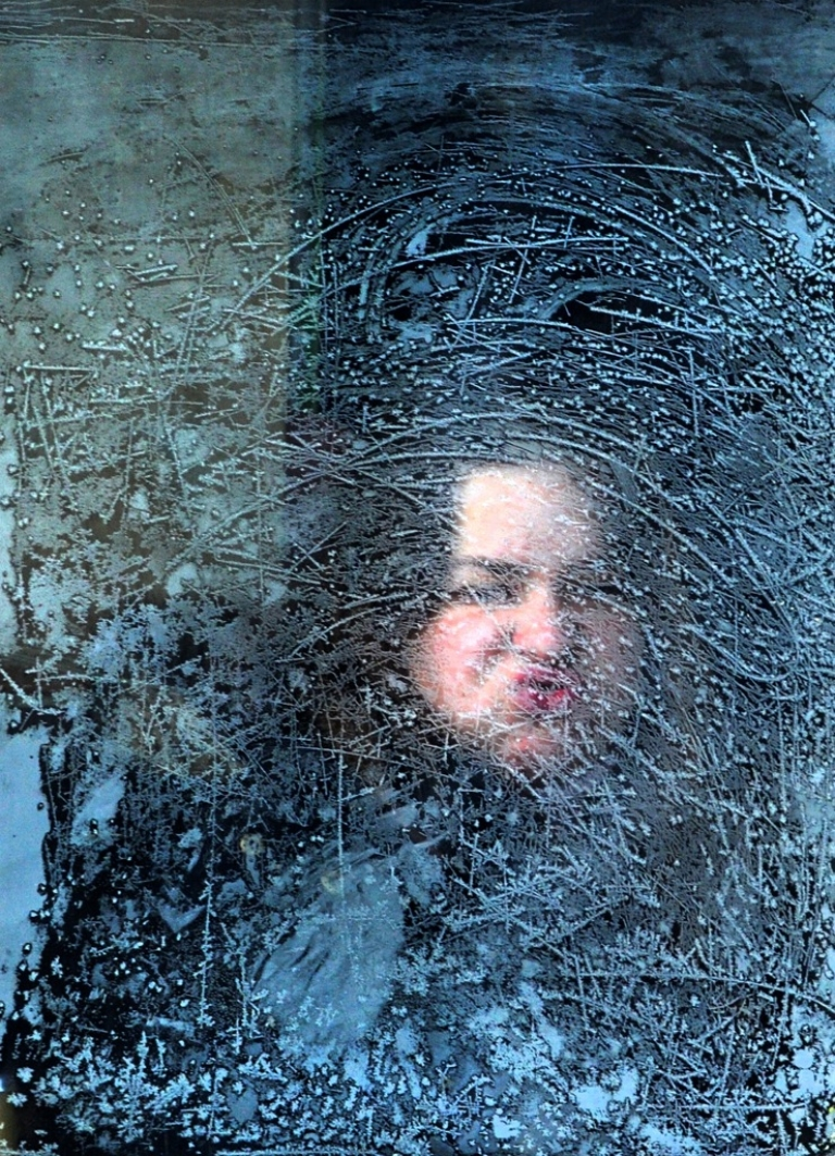 <p>A woman looks through an icy window on a tram in Sofia on January 31, 2012. Record low temperatures were registered around Bulgaria on Tuesday, threatening shipping on the Danube and closing hundreds of schools.</p>