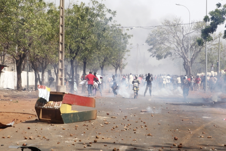 <p>Relatives and supporters of soldiers fighting rebels Tuareg in the north, clash with security forces during a protest against the 'weak' response to attacks by the rebels, in Bamako on February 2, 2012.</p>