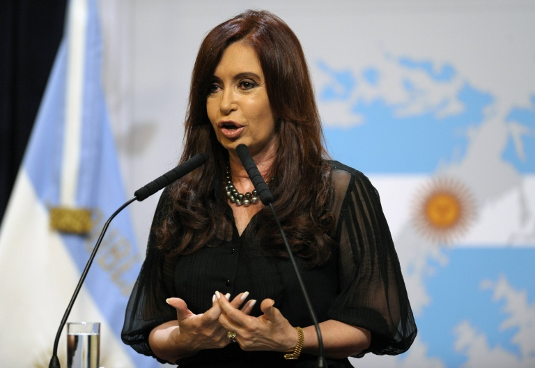 <p>Argentine President Cristina Fernandez de Kirchner delivers a speech in front of a backdrop displaying the Falkland Islands (Malvinas in Spanish) painted like the Argentine national flag at the Government Palace in Buenos Aires on February 7, 2012.</p>
