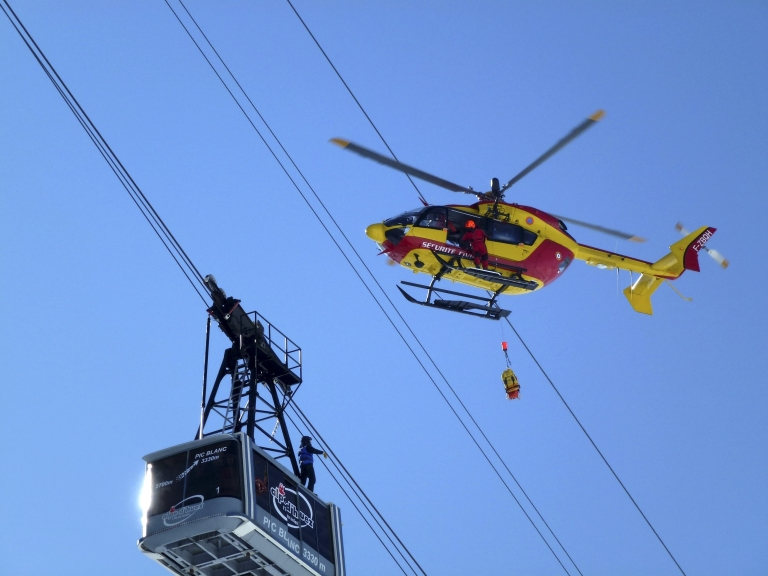 <p>In a separate rescue, French gendarmes used a helicopter to evacuate people from a telecabin in the French ski resort of Alpe d'Huez on February 11, 2012.</p>