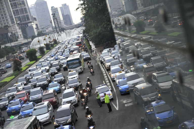 <p>In this photograph taken on February 10, 2012 cars and public transports are jammed during rush hour traffic at Jakarta's main Thamrin avenue. Automakers from Japan to India are eyeing a bonanza in Indonesia, Southeast Asia's largest economy and a new growth market for cars.</p>