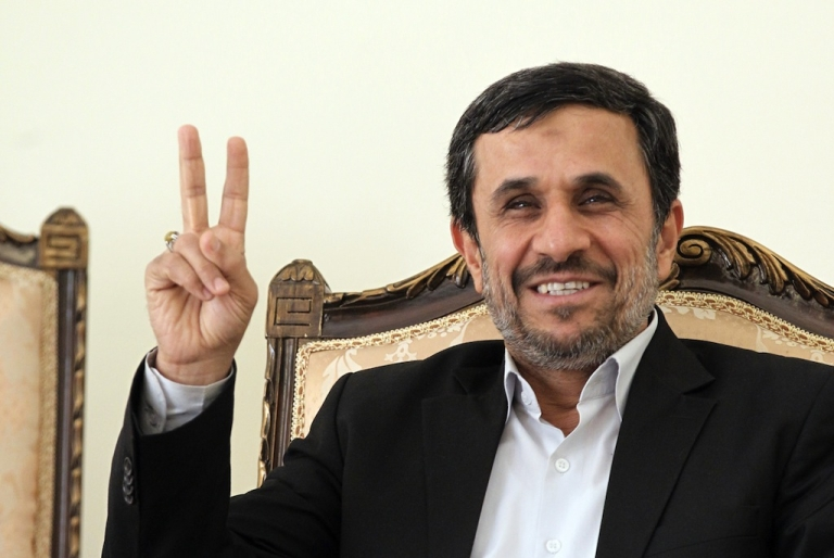 <p>Iranian President Mahmoud Ahmadinejad flashes the V-sign for victory as he waits for the arrival of Ismail Haniya, Palestinian Hamas premier in the Gaza Strip, for a meeting in Tehran on February 12, 2012.</p>