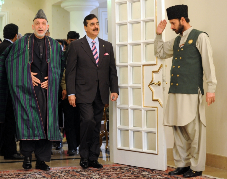 <p>Hamid Karzai, Afghanistan's President, arrives with Pakistan's Prime Minister Yousuf Raza Gilani (2R) at the Prime Minister's House in Islamabad on February 16, 2012.</p>