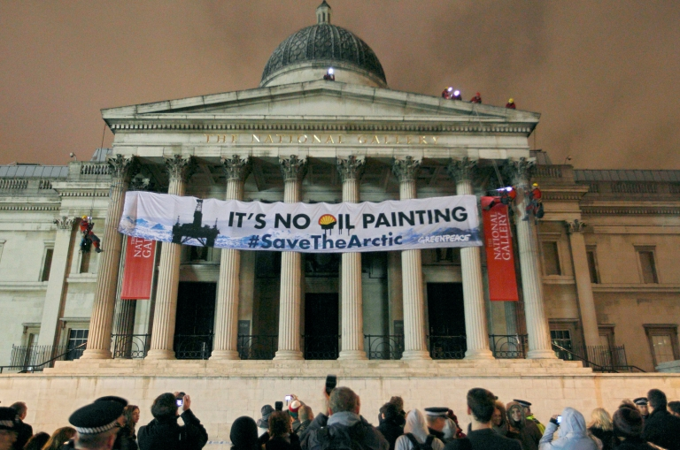 <p>Greenpeace protesters scale the pillars of the National Gallery in central London, on February 21, 2012, as they unfurl a banner in protest at oil firm Shell's plans for drilling oil in the Arctic.</p>