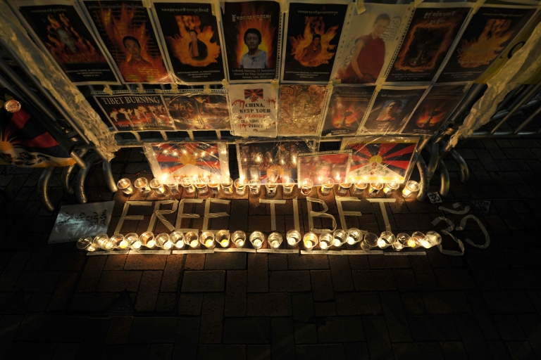<p>A Free Tibet candlelit display showing the pictures of Tibetans who died of self immolation is seen during a protest in front of the Liaison Office of the Central People's Government in the Hong Kong Special Administrative Region on February 22, 2012.</p>