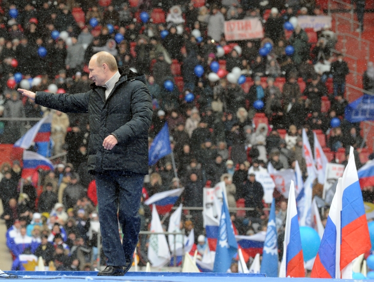 <p>Russian Presidential candidate, Prime Minister Vladimir Putin gestures during a rally of his supporters at the Luzhniki stadium in Moscow on February 23, 2012.</p>