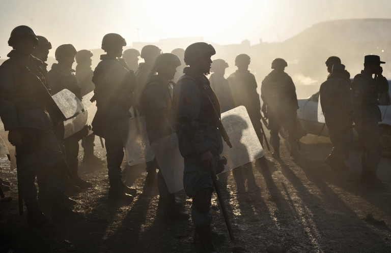 <p>Afghan riot police stand guard during a protest against Quran desecration in Kabul on February 24, 2012.</p>