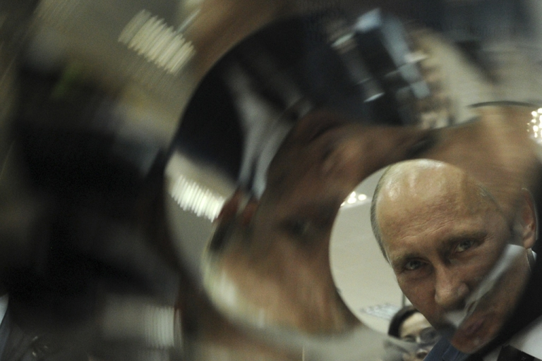 <p>Russian Prime Minister and presidential candidate Vladimir Putin looks at an X-ray mirror of a telescope during his visit to a nuclear center in Sarov.</p>