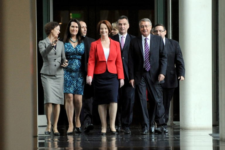 <p>Prime Minister Julia Gillard arrives with supporters for the caucus meeting in Canberra, Monday, Feb. 27, 2012.</p>