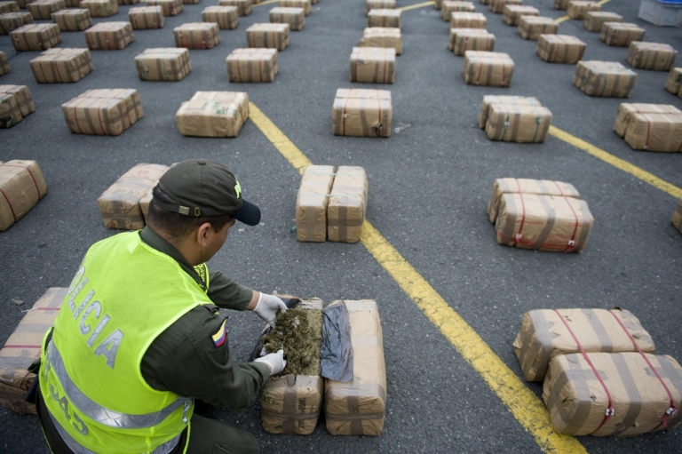 <p>A Colombian anti-drugs police officer checks packages of marijuana, part of a load of five tons seized in the outskirts of Cali, in Colombia's department of Valle del Cauca. Four tons of marijuana were found floating off the coast of California in the Pacific Ocean on May 21, 2012.</p>
