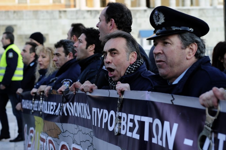 <p>Policemen shout slogans during a demonstration of Greek security forces against the new austerity measures in Athens on February 28, 2012.</p>