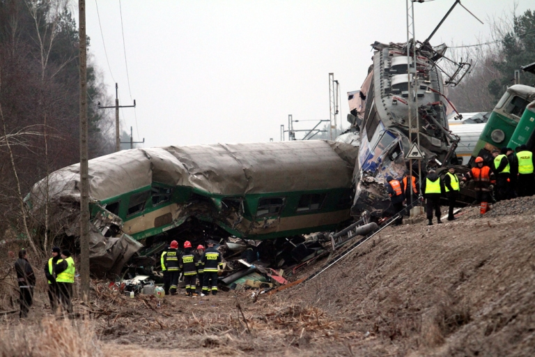 <p>Rescuers work at the scene of a train crash in Szczekociny near Zawiercie (Silesia) in Poland today. Two passenger trains collided late Saturday, injuring more than 60 passengers. At least 16 people died.</p>