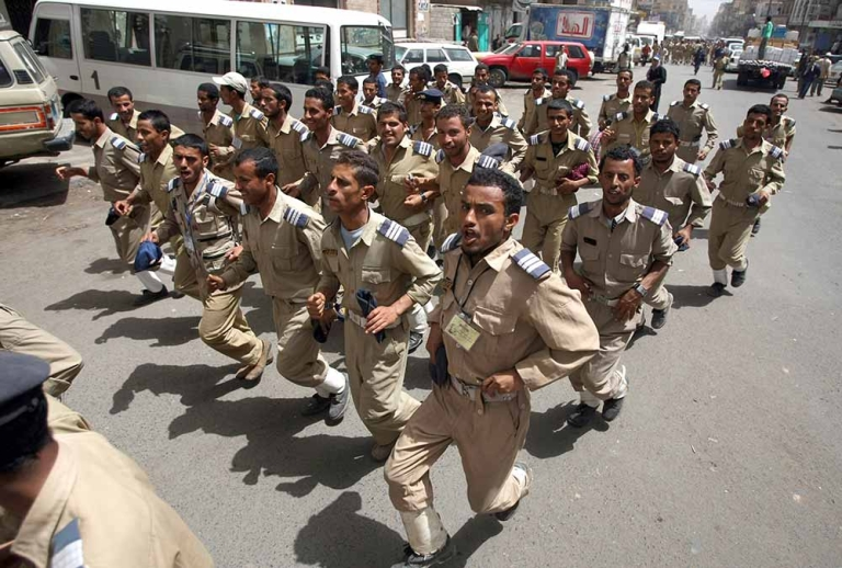 <p>Yemeni air force soldiers march during a protest in the capital Sanaa, on March 4, 2012, demanding the ouster of military chiefs over accusations of corruption. MOHAMMED HUWAIS/AFP/Getty Images</p>