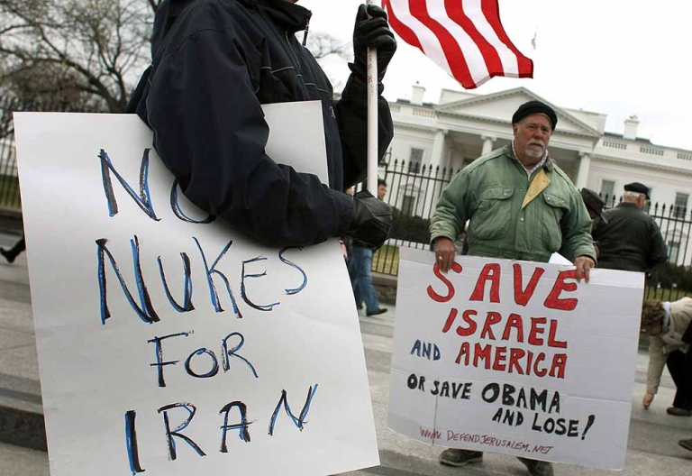 <p>Bob Kunst (R) protests against a nuclear Iran in front of the White House where Israeli Prime Minister Benjamin Netanyahu is visiting on March 5, 2012 in Washington, DC. President Obama met with Prime Minister Netanyahu to discuss peace in the Middle East, and Israel's growing concerns with Iran producing nuclear weapons.</p>