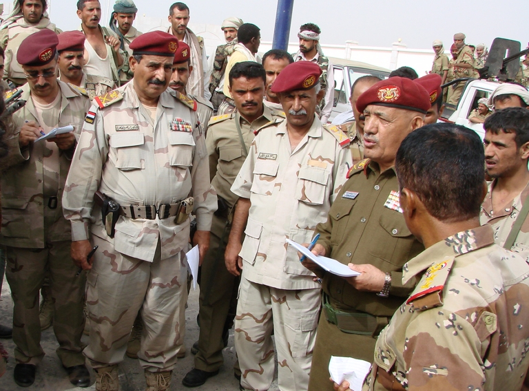 <p>Yemeni General Ali Salah, deputy chief of staff for military operations, speaks to defence officials as he visits Yemen's restive Abyan province on March 6, 2012.</p>