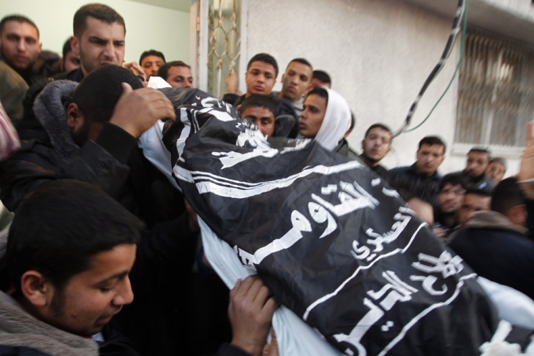 <p>Palestinian mourners carry the body of Zohair al-Qaisi, general-secretary of the Popular Resistance Committee, after he was killed along with PRC member Mahmud Halani after an Israeli air strike in Gaza City today.</p>