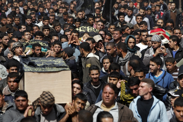 <p>Palestinian mourners carry the bodies of seven Islamic Jihad militants today in Gaza City. As many as 15 Palestinian fighters died and 20 people wounded in a series of Israeli air strikes on the Gaza Strip that began on Friday.</p>