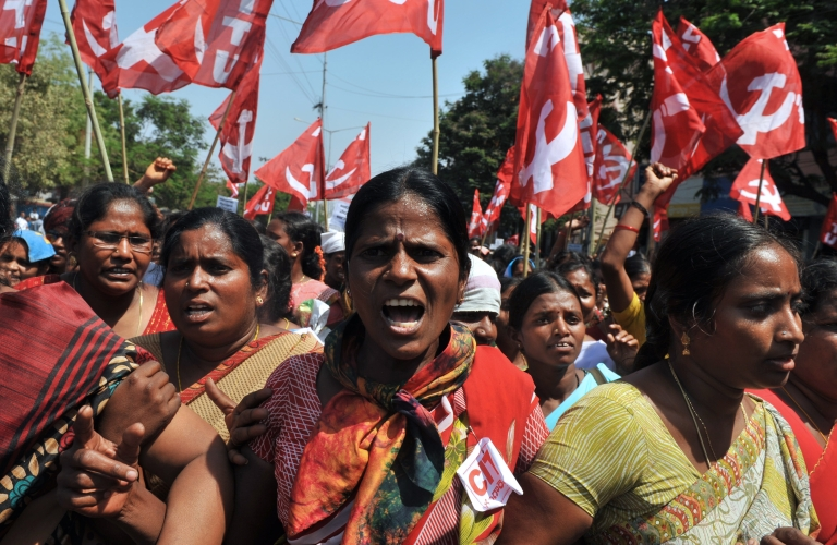 <p>Women of the Andhra Pradesh Voluntary Health Workers' Union shout slogans during a protest as they head towards the state legislative assembly building in Hyderabad, India on March 12, 2012. The demonstrators demanded immediate implementation of increased wages and regular monthly payments, uniforms, travelling and daily allowances.</p>