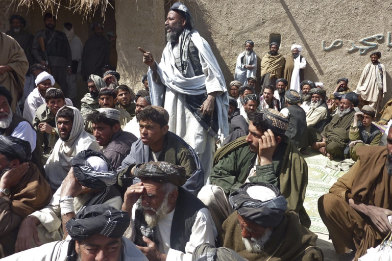 <p>Afghan men gather for a service in Alokozai, Kandahar, on Tuesday for 16 civilians suspected to have been killed on Sunday by a rogue US soldier.</p>