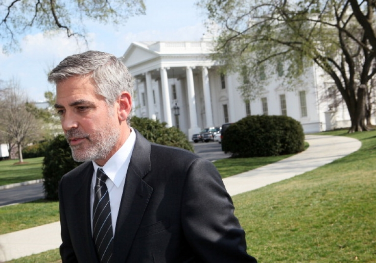 <p>Actor George Clooney leaves after he spoke to the media March 15, 2012 at the White House in Washington, DC.</p>