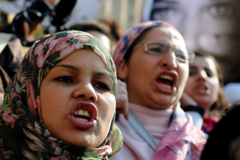 <p>Egyptian women shout political slogans during a demonstration in Cairo on March 16, 2012, in solidarity with Samira Ibrahim, an Egyptian woman who brought a case against an army doctor, Ahmed Adel, accused of conducting forced 'virginity tests' on female protestors. Adel was cleared of conducting the test on Samira Ibrahim after the judge found the witness statements to be 'contradictory', the official MENA news agency said.</p>