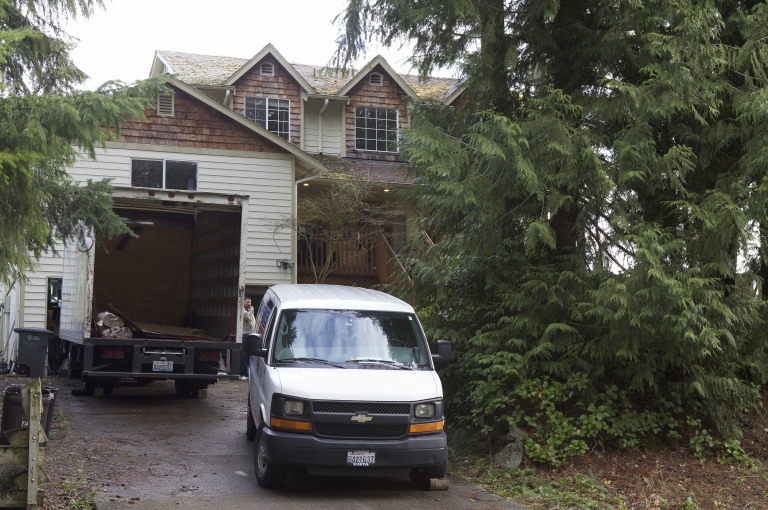 <p>The home of Robert Bales is pictured with a pair of moving vans outside March 19, 2012 in Lake Tapps, Washington.</p>