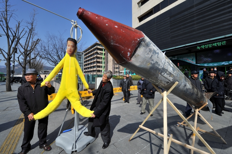 <p>South Korean conservative activists hang an effigy of North Korean leader Kim Jong-Un next to a mock North Korean missile during a rally denouncing the North's announcement of a planned satellite launch, in Seoul on March 20, 2012.</p>