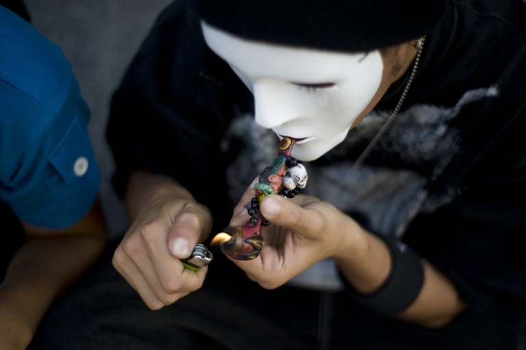 <p>A man smokes marijuana during a march calling for the decriminalization of marijuana on March 23 in Guatemala City, a day before that the presidents of Central America discussed alternatives to combat drug trafficking.</p>