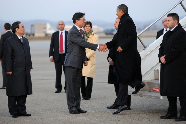 <p>US President Barack Obama meets US ambassador Sung Kim as he disembarks from Air Force One at Osan Air Base in Pyongtaek, some 40 miles south of Seoul, on Sunday.</p>